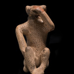 Etrusco-Corinthian aryballos in the form of a monkey, 7th-early 6th century BC