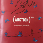 """Red Auction Catalogue signed by Bono and Hirst"""