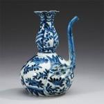 A CHINESE BLUE AND WHITE KRAAK 'POMEGRANATE EWER' KENDI, 1595-1610