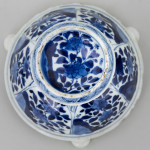 A NEAR PAIR OF CHINESE BLUE AND WHITE TRIPOD SALTS, Kangxi (1662-1722)