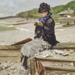 WOMAN READING AT THE SEASHORE