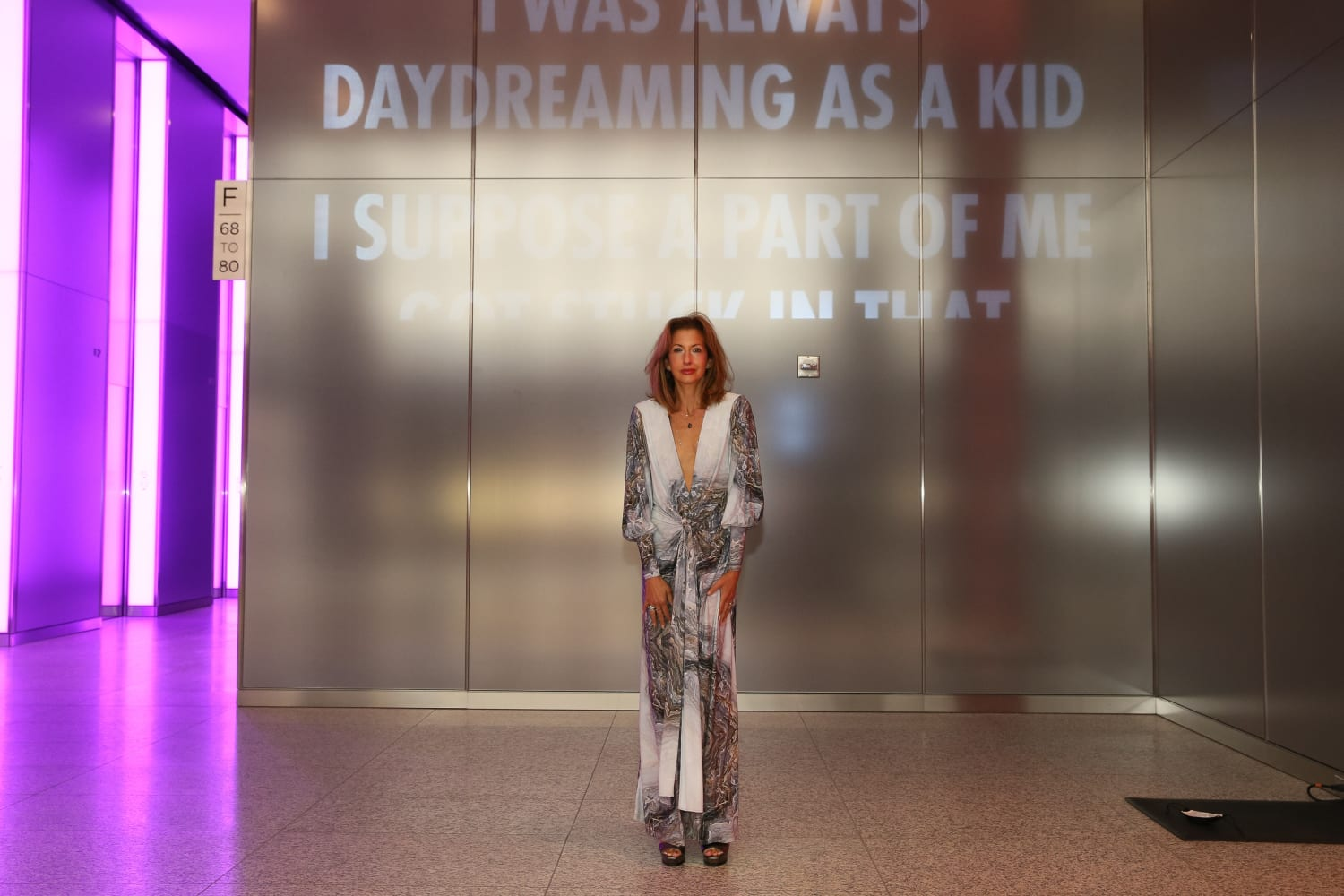 Alysia Reiner in front of Jenny Holzer x Silver Art Unveiling