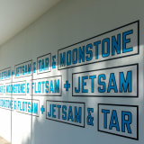 Installation view of a work by Lawrence Weiner at Venet Foundation in France; The statement reads, as follows, in both English and French: ⠀ ⠀ Flotsam + Jetsam + Tar + Moonstone ⠀ Tar + Moonstone + Flotsam + Jetsam⠀ Moonstone + Flotsam + Jetsam + Tar⠀ ⠀ D