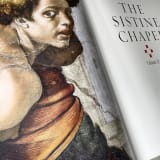 open page of the new publication THE SISTINE CHAPEL TRILOGY showing a detail of a Michelangelo portrait