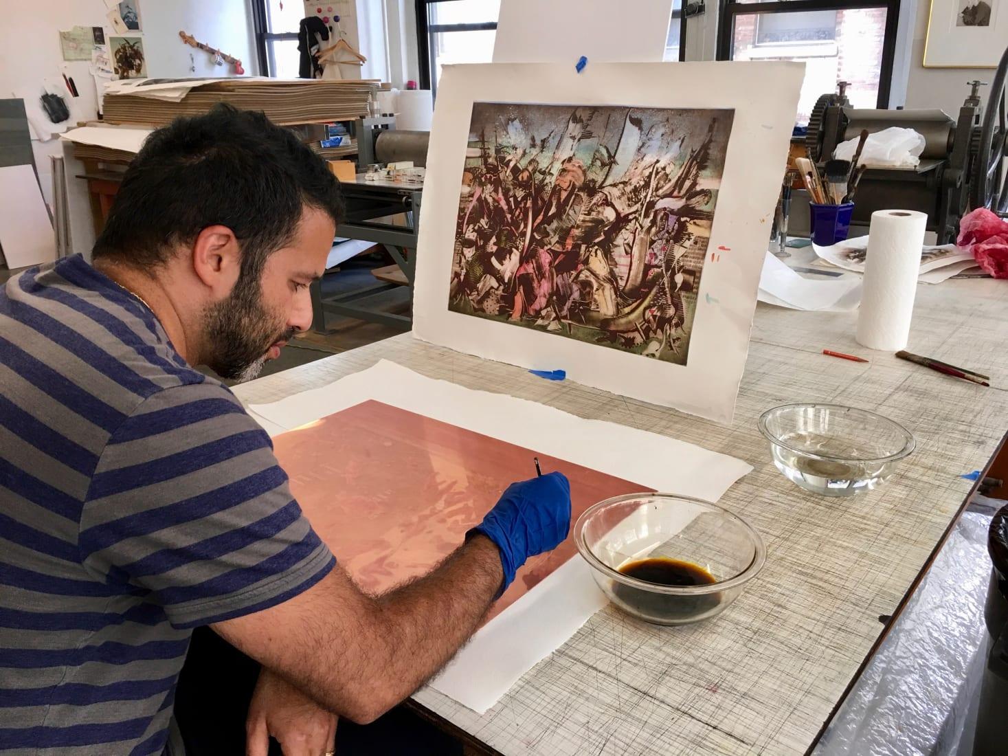 <p><span>Ali Banisadr working on plates at Burnet Editions, New York, 2019. Photo: Greg Burnet.</span></p>