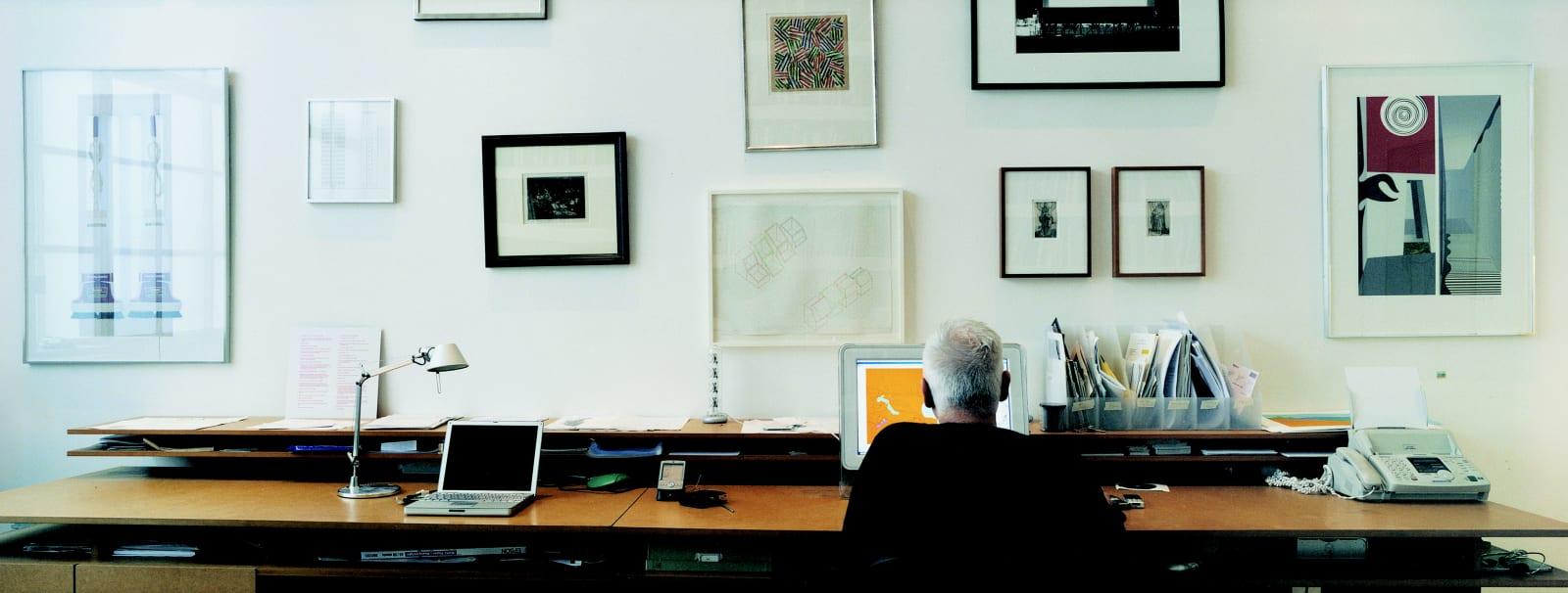 <p>Studio photo of Michael Craig-Martin with his collection of original prints.</p>