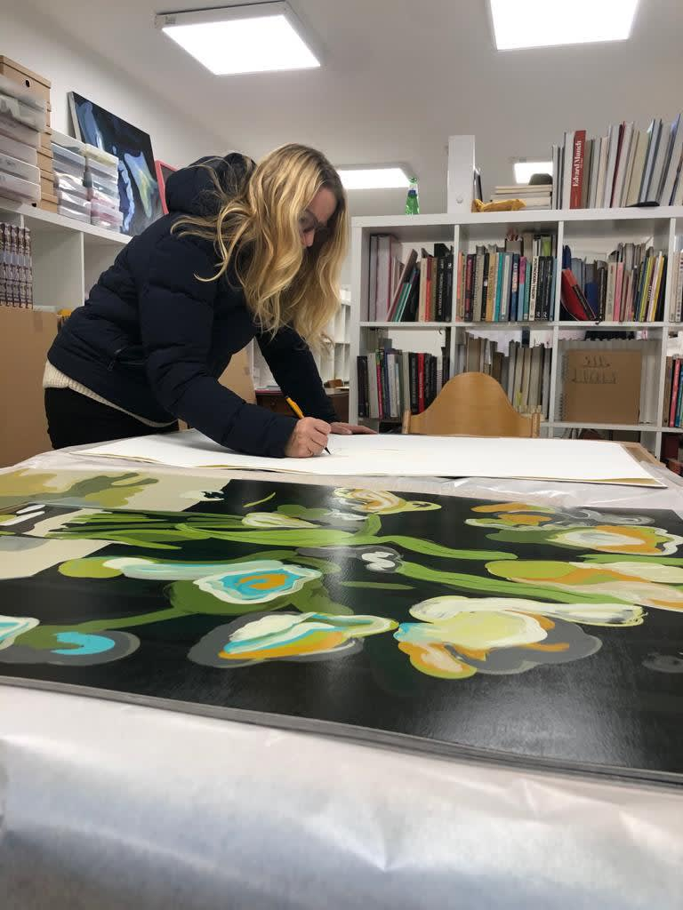 <p>Clare Woods singing new prints in her studio in Herefordshire, UK, in January 2021. Photo: Sid Hughes.</p>