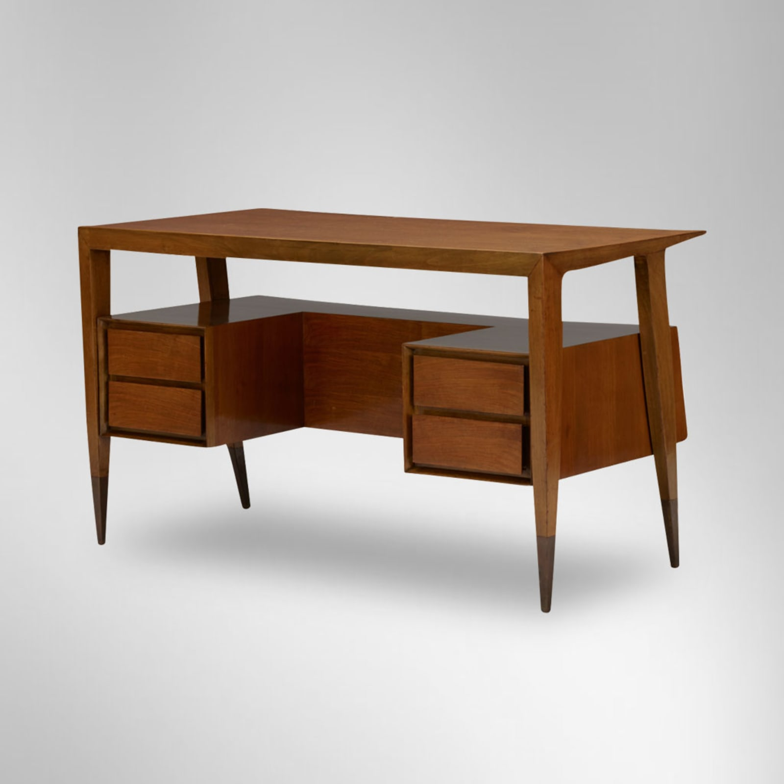 Gio Ponti  Desk, early 1950's  Italy  wood, with brass sabots on tapering feet  With Certificate of Authenticity (no. 19156/000) from the Gio Ponti Archives.  H 74 / L 128 / D 65 cm