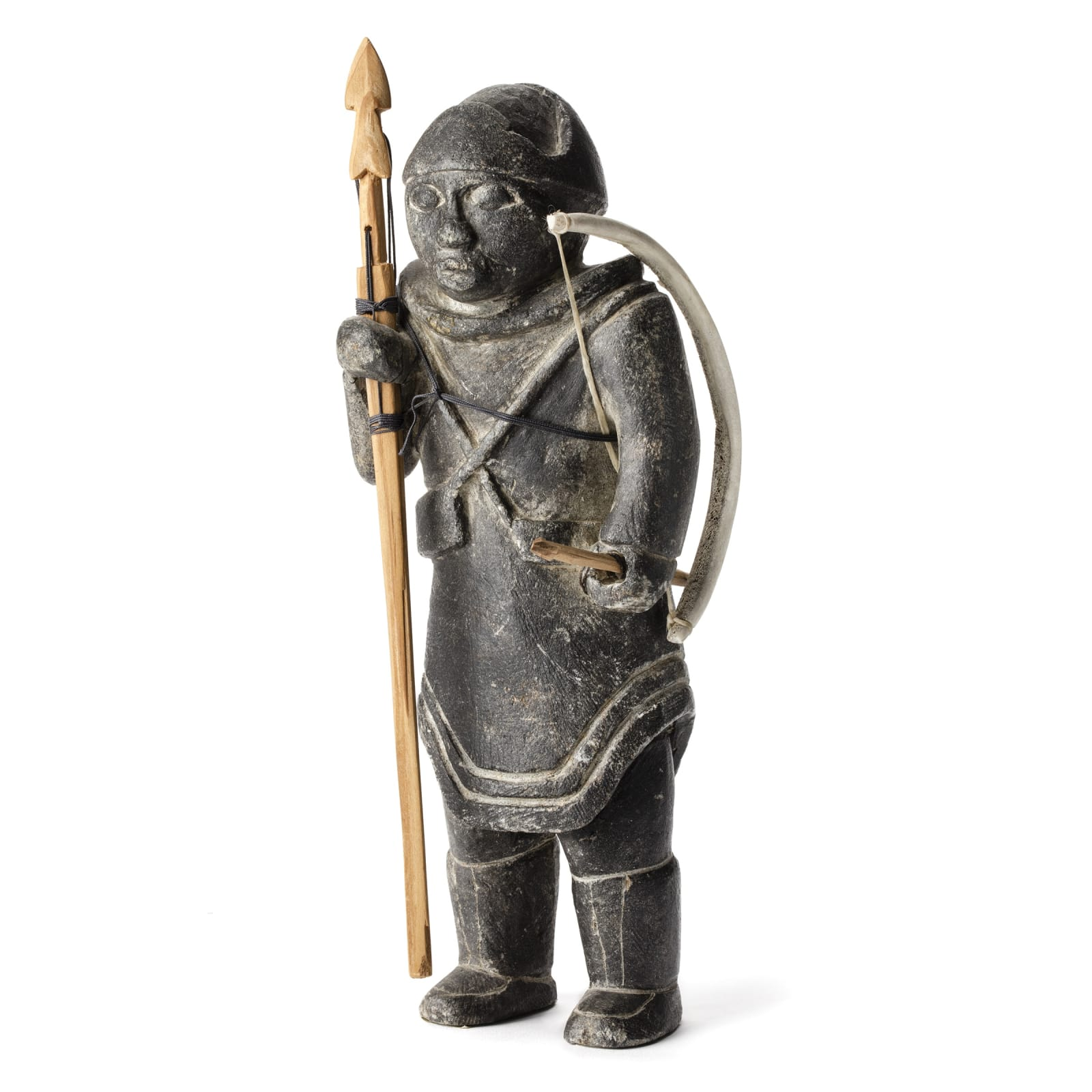 JOE TALIRUNILI (1893-1976) PUVIRNITUQ (POVUNGNITUK)  Hunter with Harpoon, Bow, and Arrow, mid-late 1960s  REALIZED: $28,800