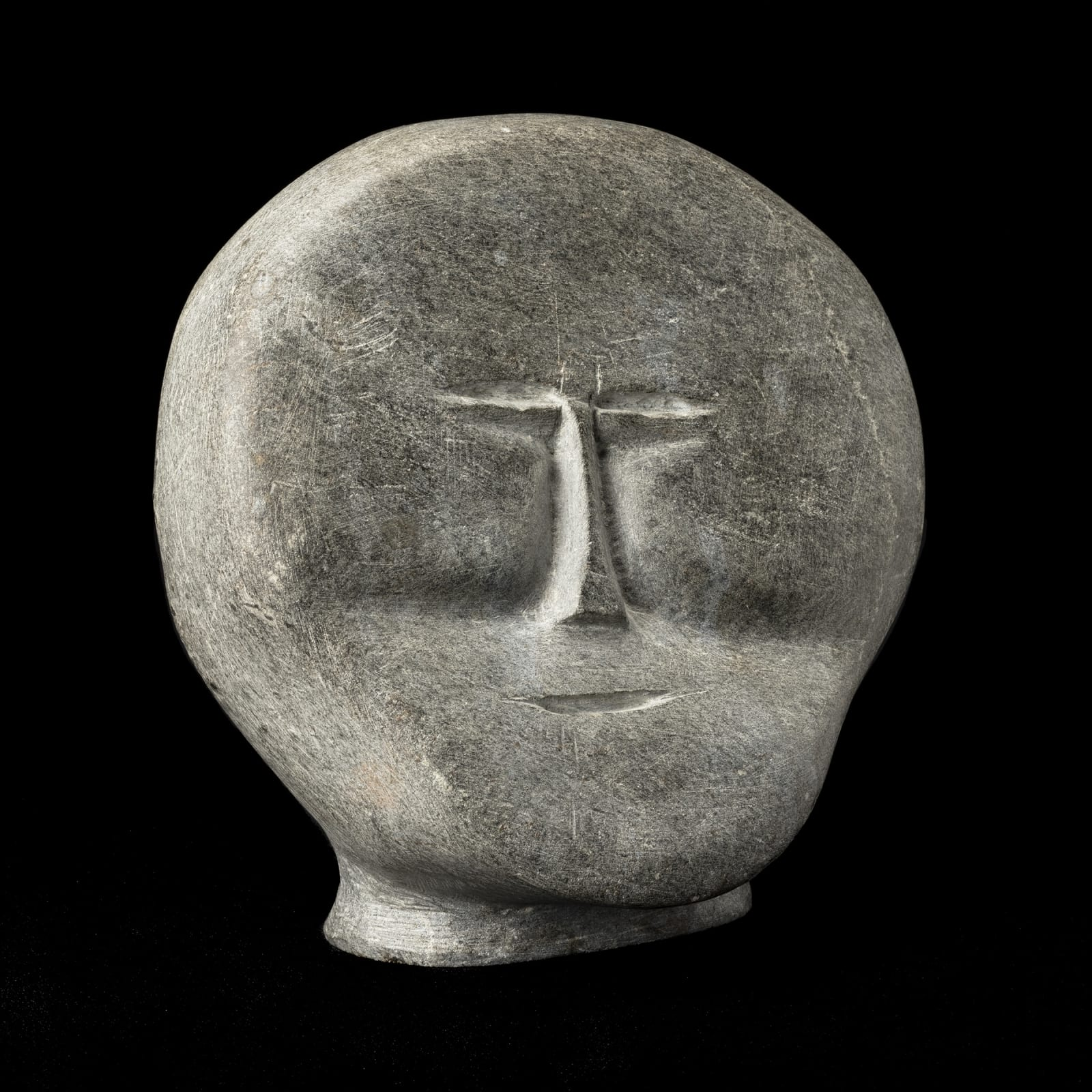 JOHN TIKTAK, R.C.A. (1916-1981) KANGIQLINIQ (RANKIN INLET)  Head, c. 1965-6  REALIZED: $28,800