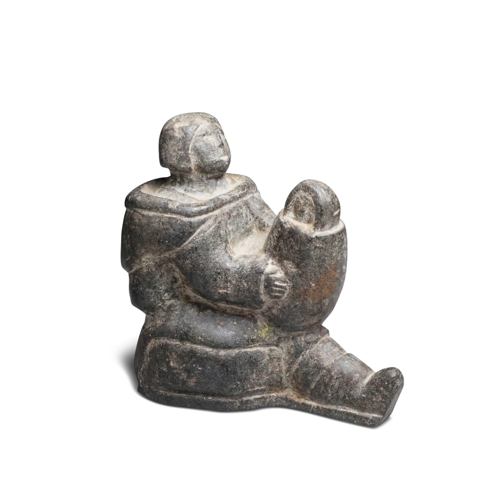 LOT 24  Possibly: MIAIJI UITANGI USAITAIJUK (1911-D), SALLUIT (SUGLUK) Mother Holding Her Swaddled Child, late 1950s stone, 5 x 2 1/2 x 4 1/2 in (12.7 x 6.3 x 11.4 cm)  ESTIMATE: $500 — $700