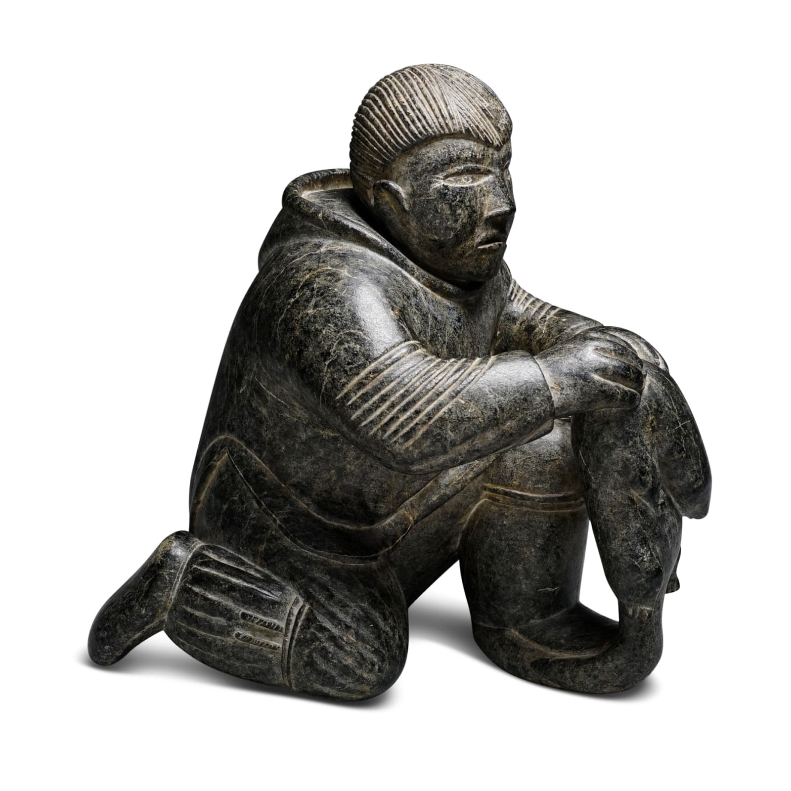 LOT 5  TIMOTHY QUANANAAPIK (1938-1984) PUVIRNITUQ (POVUNGNITUK)  Hunter with Lemming, 1957  stone, 9 x 8 1/2 x 5 in (22.9 x 21.6 x 12.7 cm)  ESTIMATE: $3,500 — $5,000  PRICE REALIZED: $4,500