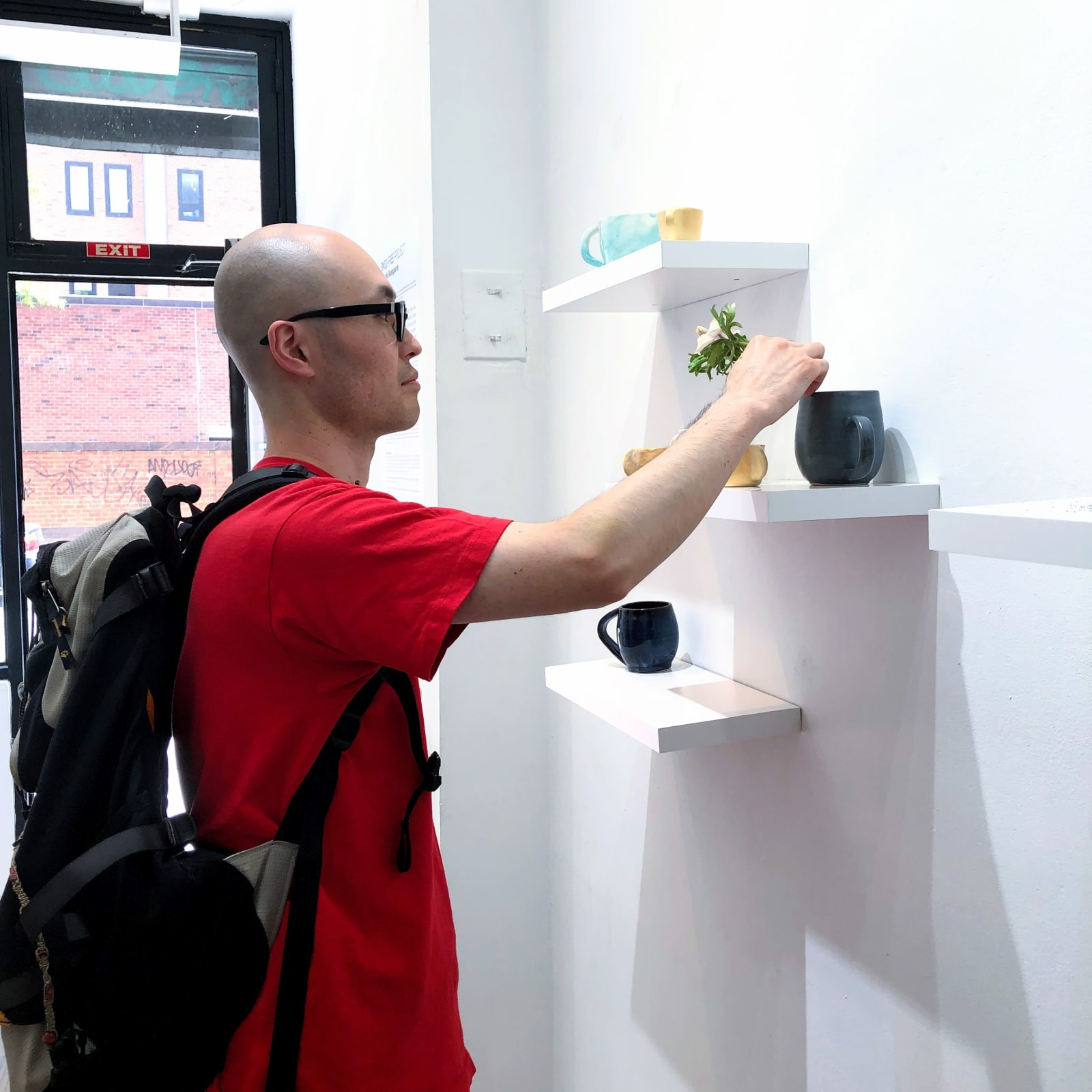 A gallery visitor interacting with Si Jie Loo's installation