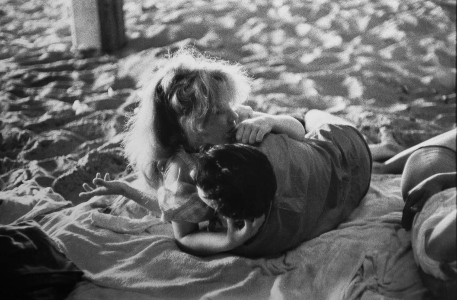 Brooklyn Gang (couple embracing on blanket under boardwalk), 1959