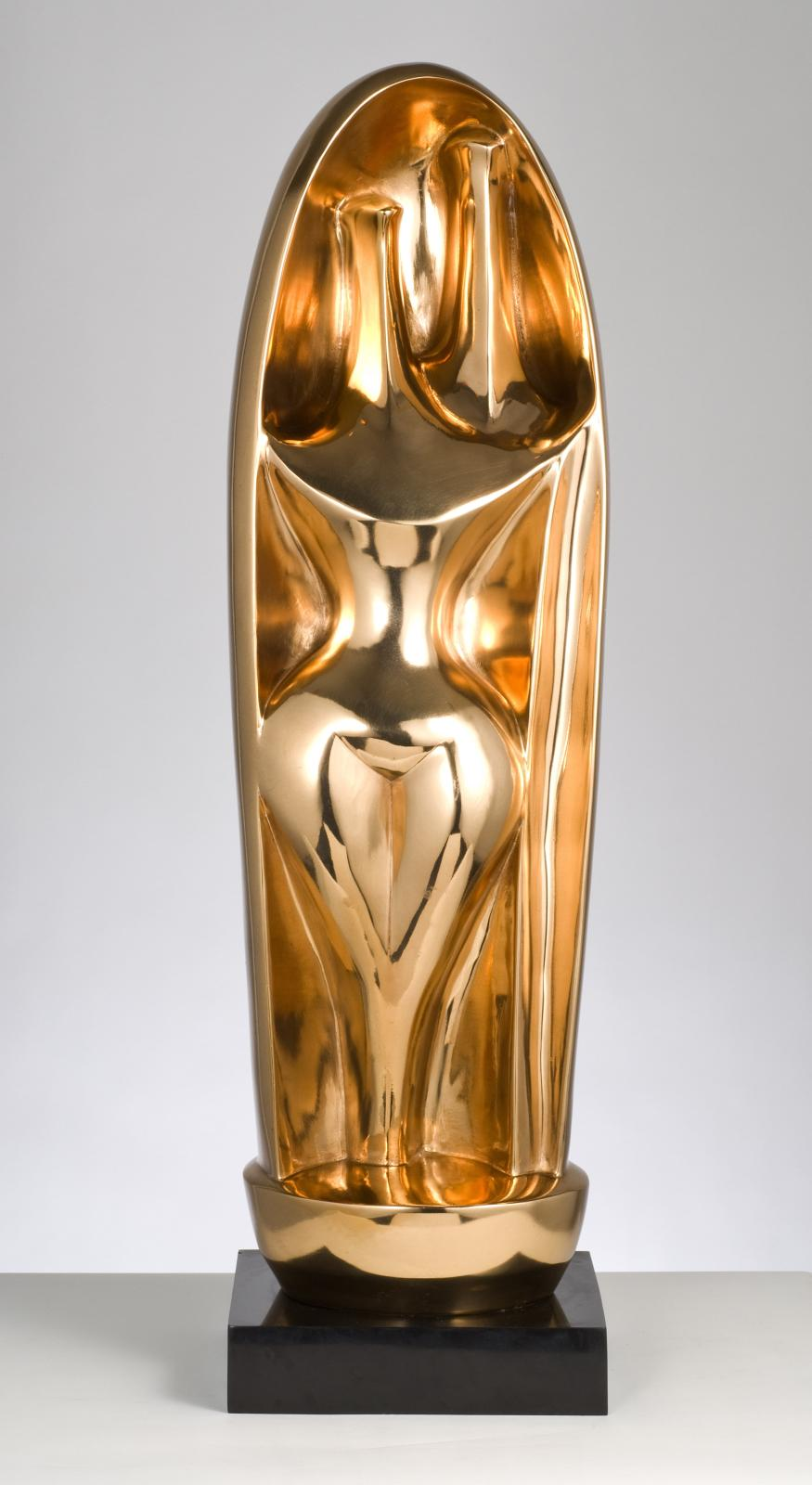 A polished bronze sculpture, two abstracted figures
