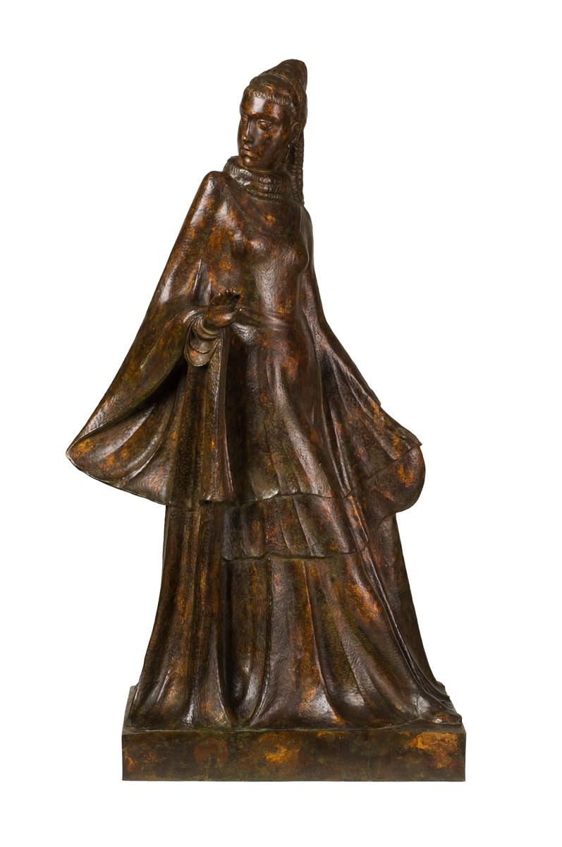 Bronze figure of a woman in a long flowing dress