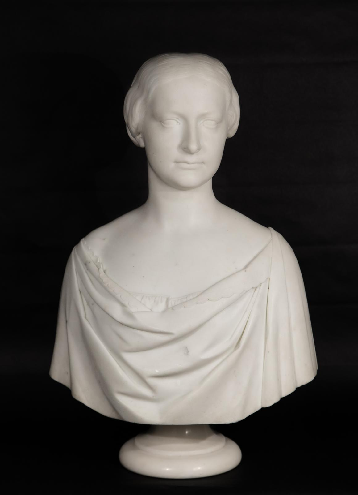 A bust of a woman in white marble