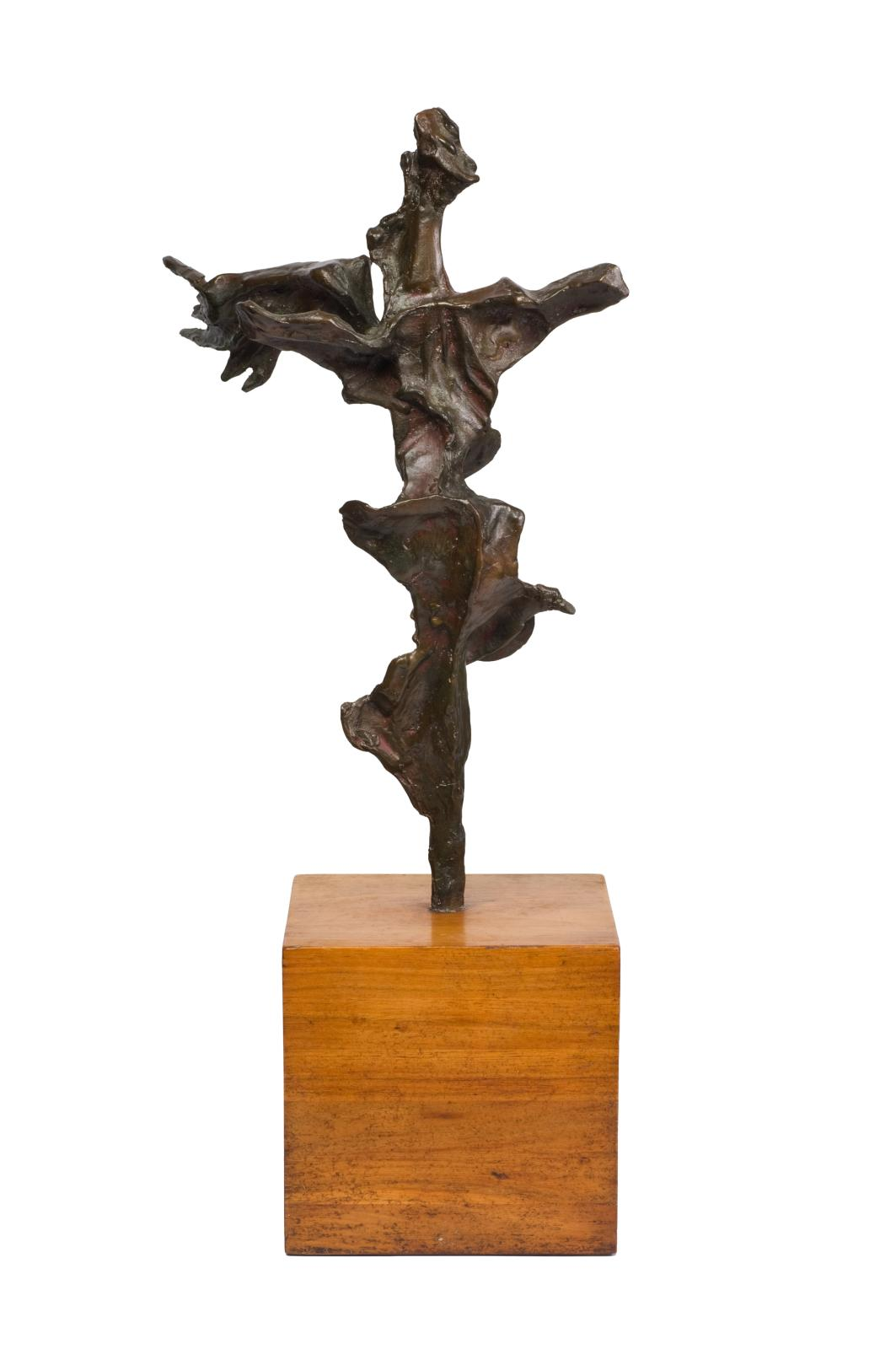 An abstract bronze sculpture representing a figure