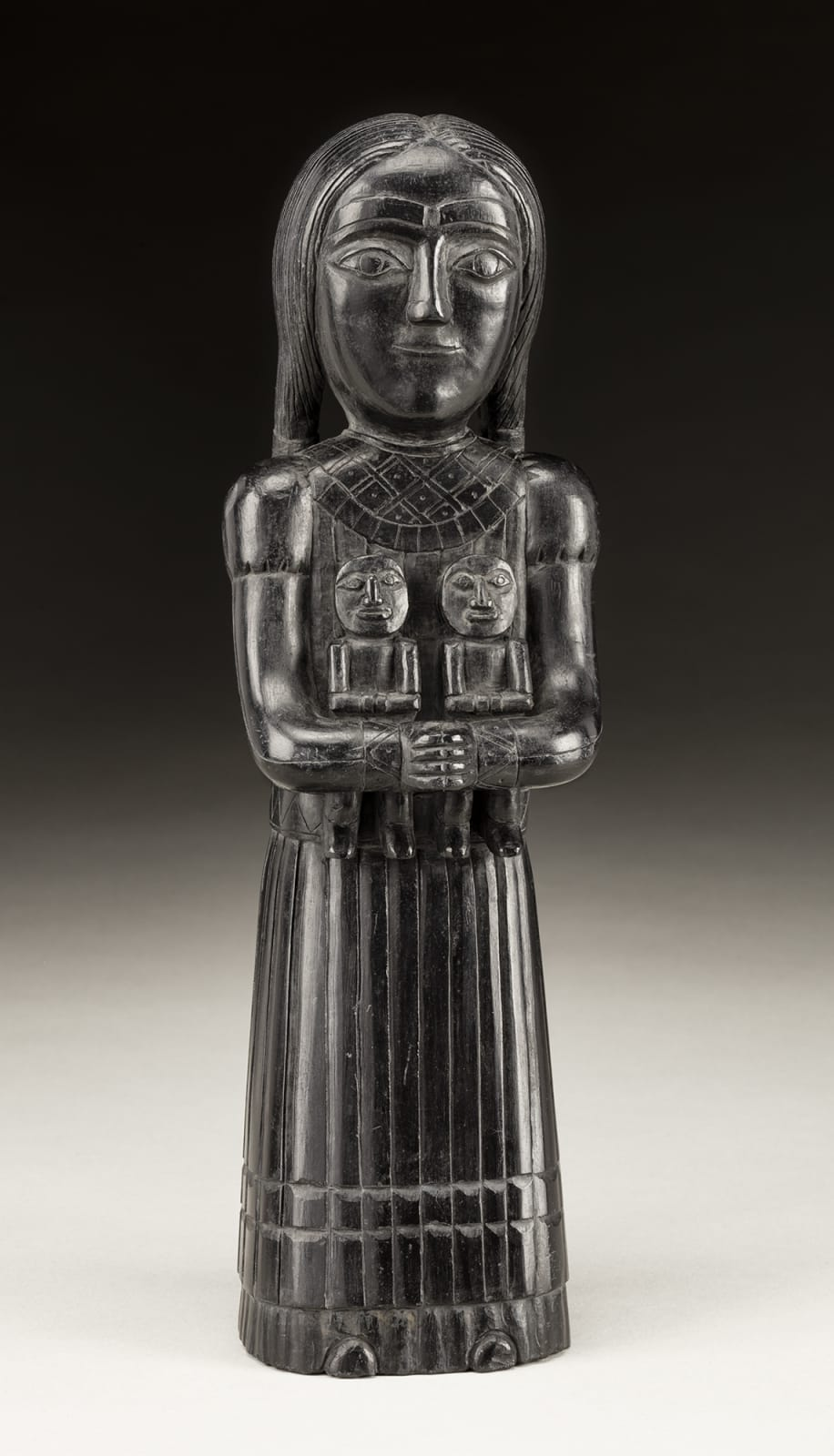 UNIDENTIFIED ARTIST, HAIDA, Female Figure Holding Two Dolls, c. 1840-1860