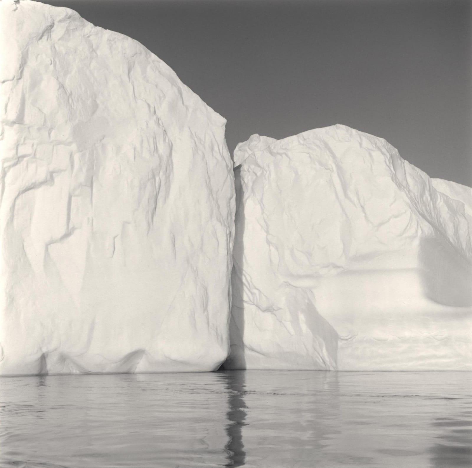 Two geometric icebergs touching in Disko Bay, Greenland by Lynn Davis