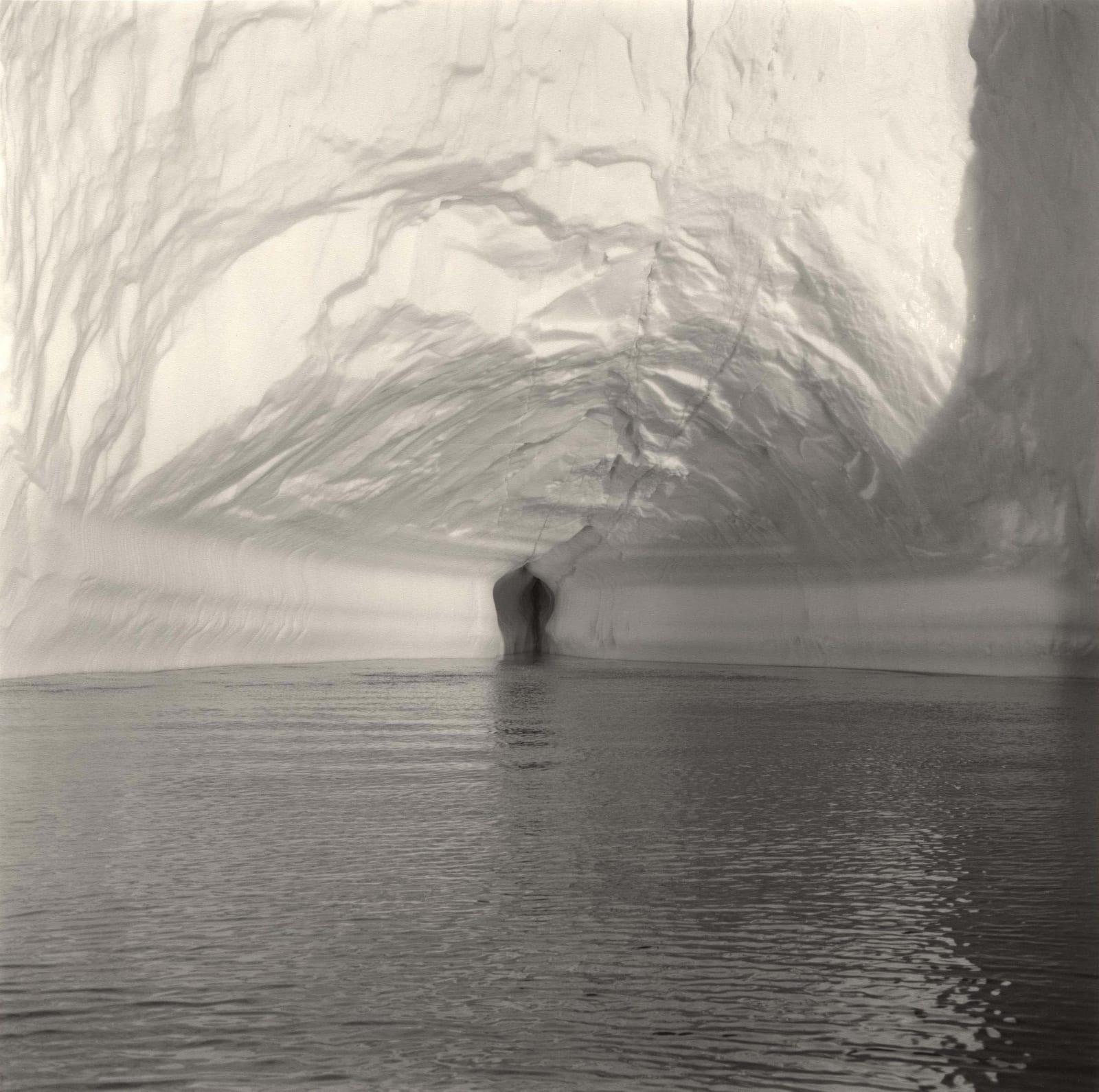 Lynn Davis photograph of small hole in center of iceberg in Disko Bay, Greenland