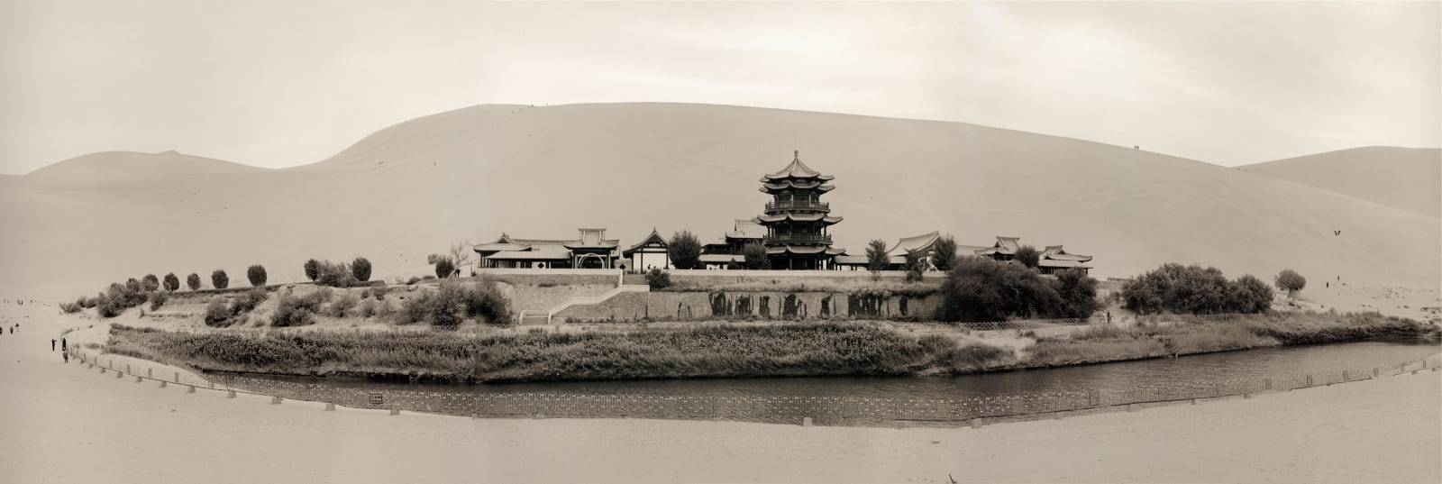 Oasis with pagoda at Crescent Moon Spring, Dunhuang in China, by Lynn Davis