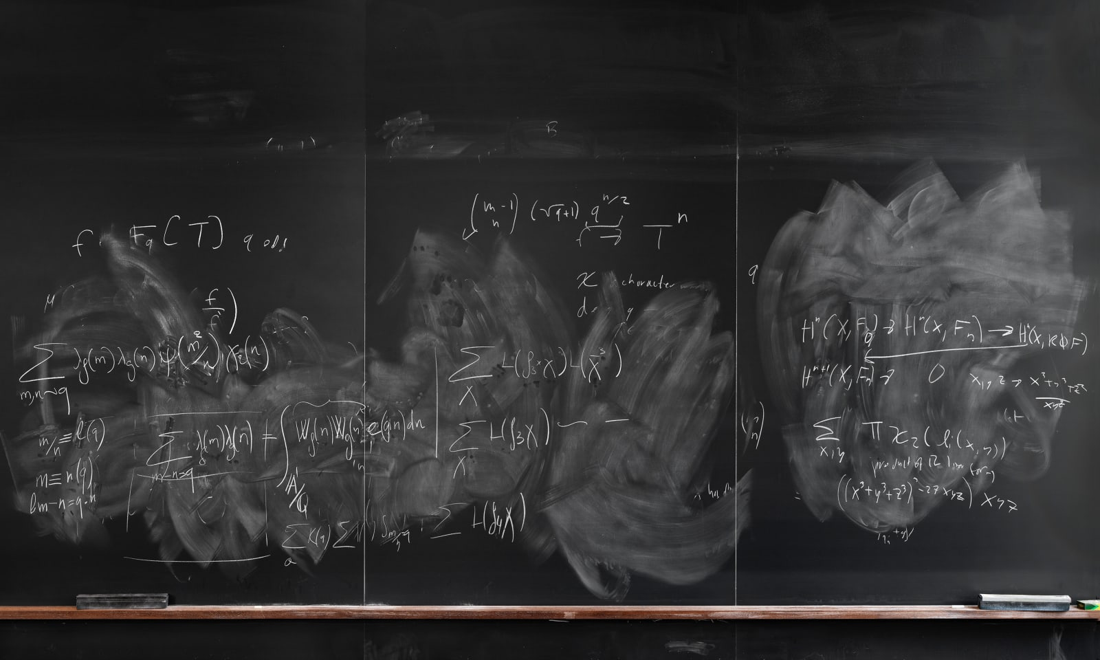 Formulas on chalkboard by mathematician Philippe Michele, from the Do Not Erase series by Jessica Wynne