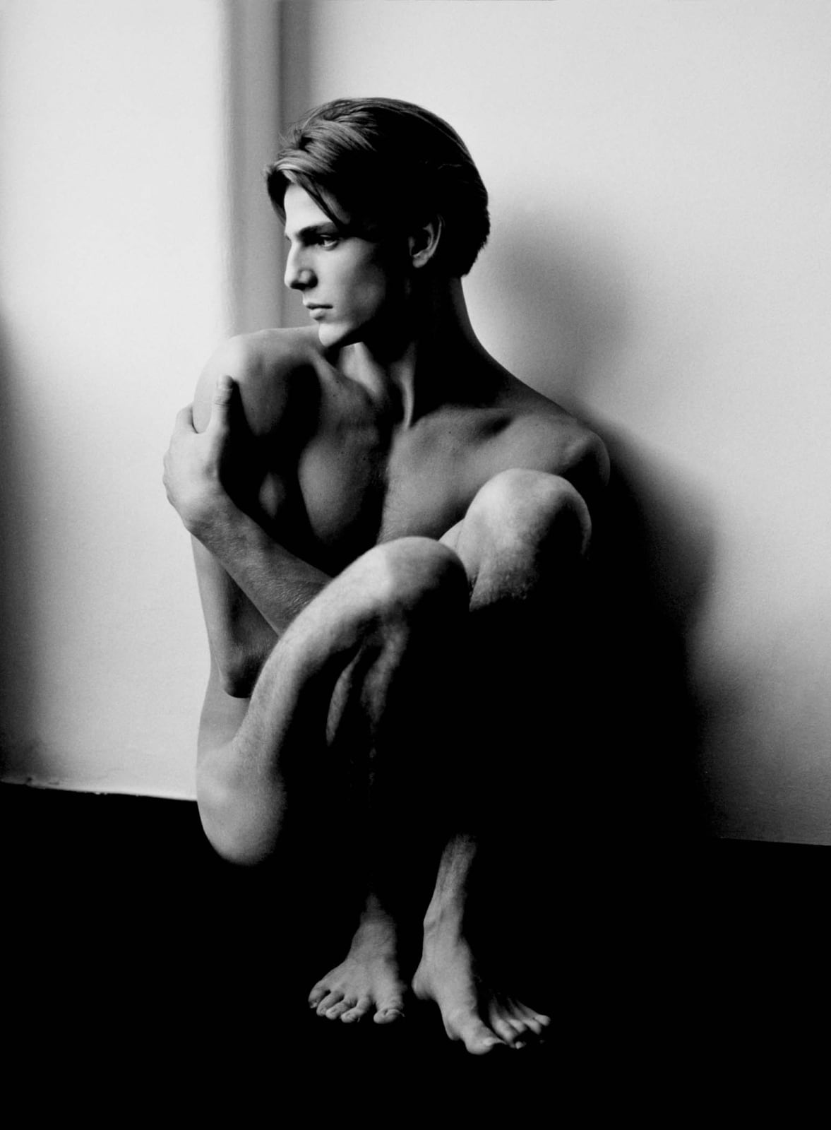 Herb Ritts photograph of male model Stephano, nude, seated, in Milan