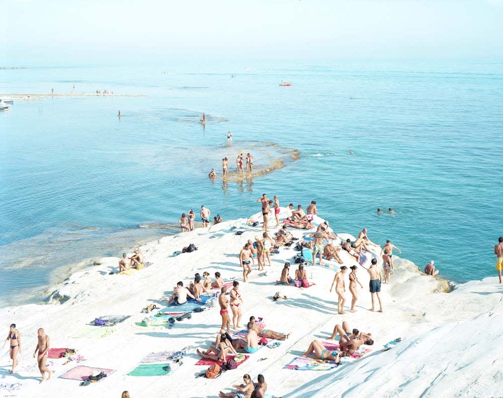 Group of beachgoers on white sand at SDT Island, by Massimo Vitali