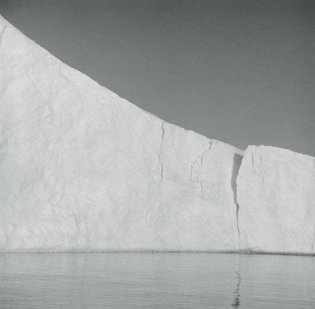 Lynn Davis photograph of sloping iceberg in Disko Bay, Greenland with hairline crack in middle
