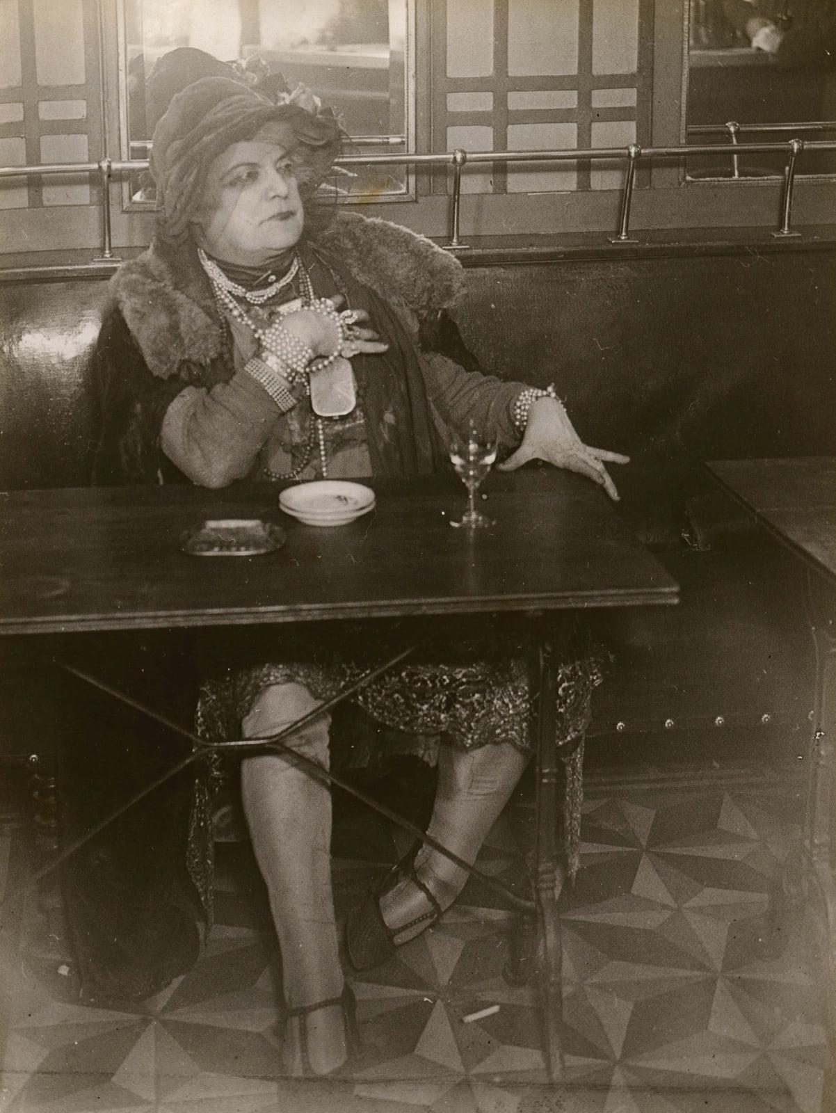 Brassaï La Môme Bijou, Bar de la Lune, Paris at bar table with drink