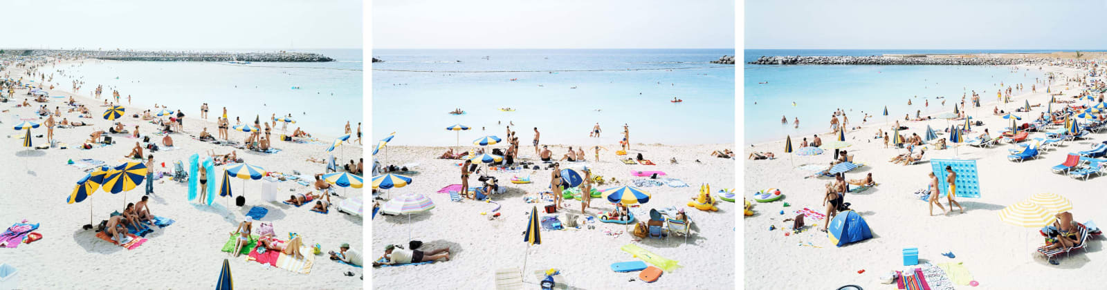 Triptych of beachgoers under bright umbrellas with towels, by Massimo VItali