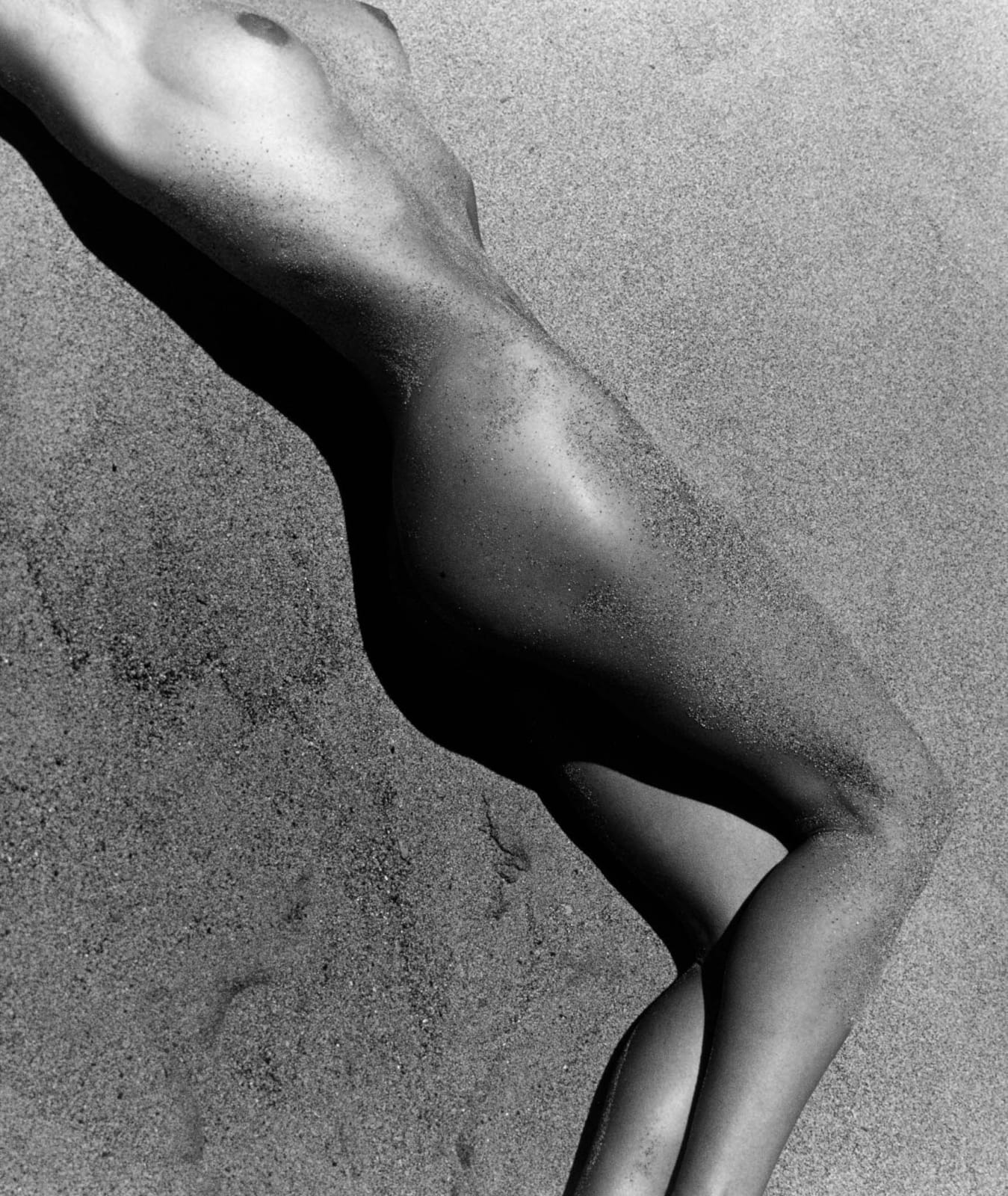 Herb Ritts photograph of nude woman's body in sand, Paradise Cove