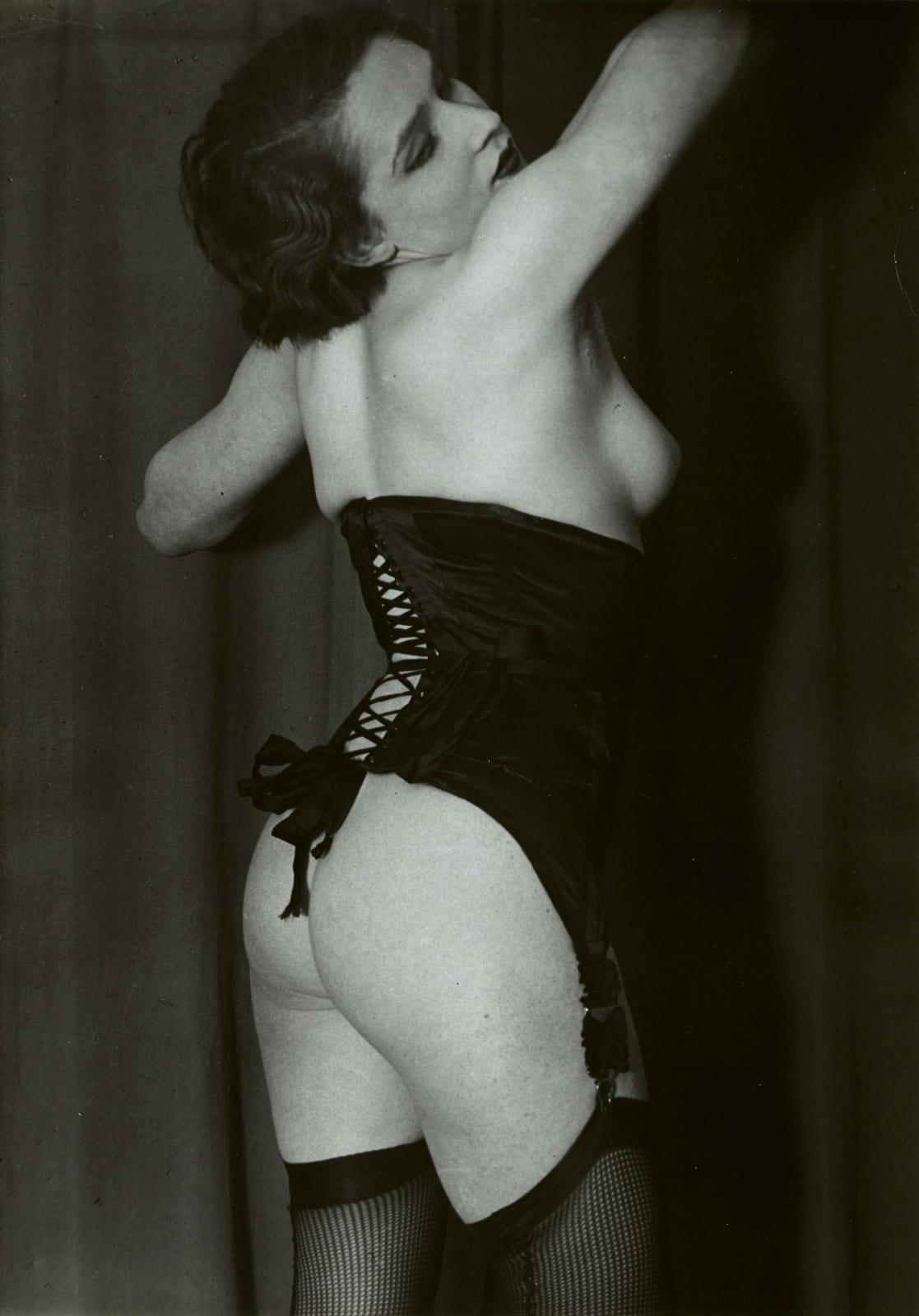 Brassai photograph of woman wearing black corset