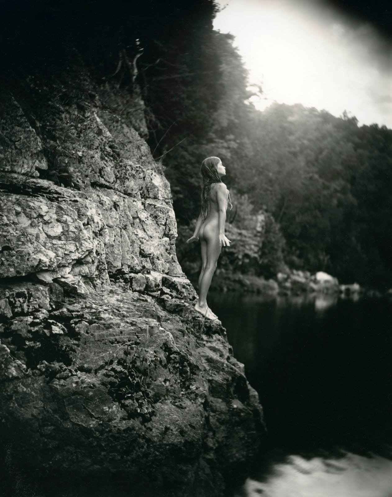 Sally Mann Immediate Family series, Jessie at 9, Jessie standing on cliff about to jump into water
