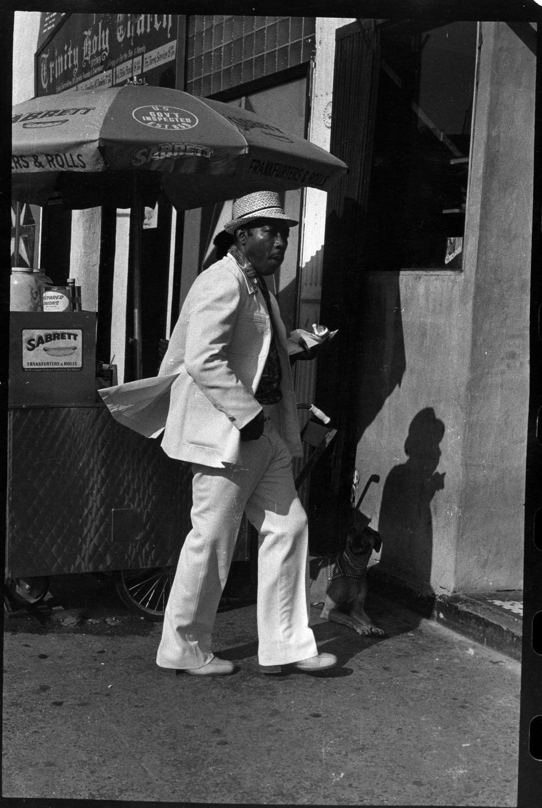 Ming Smith, Homeboy with Snack, Harlem, New York, 1976