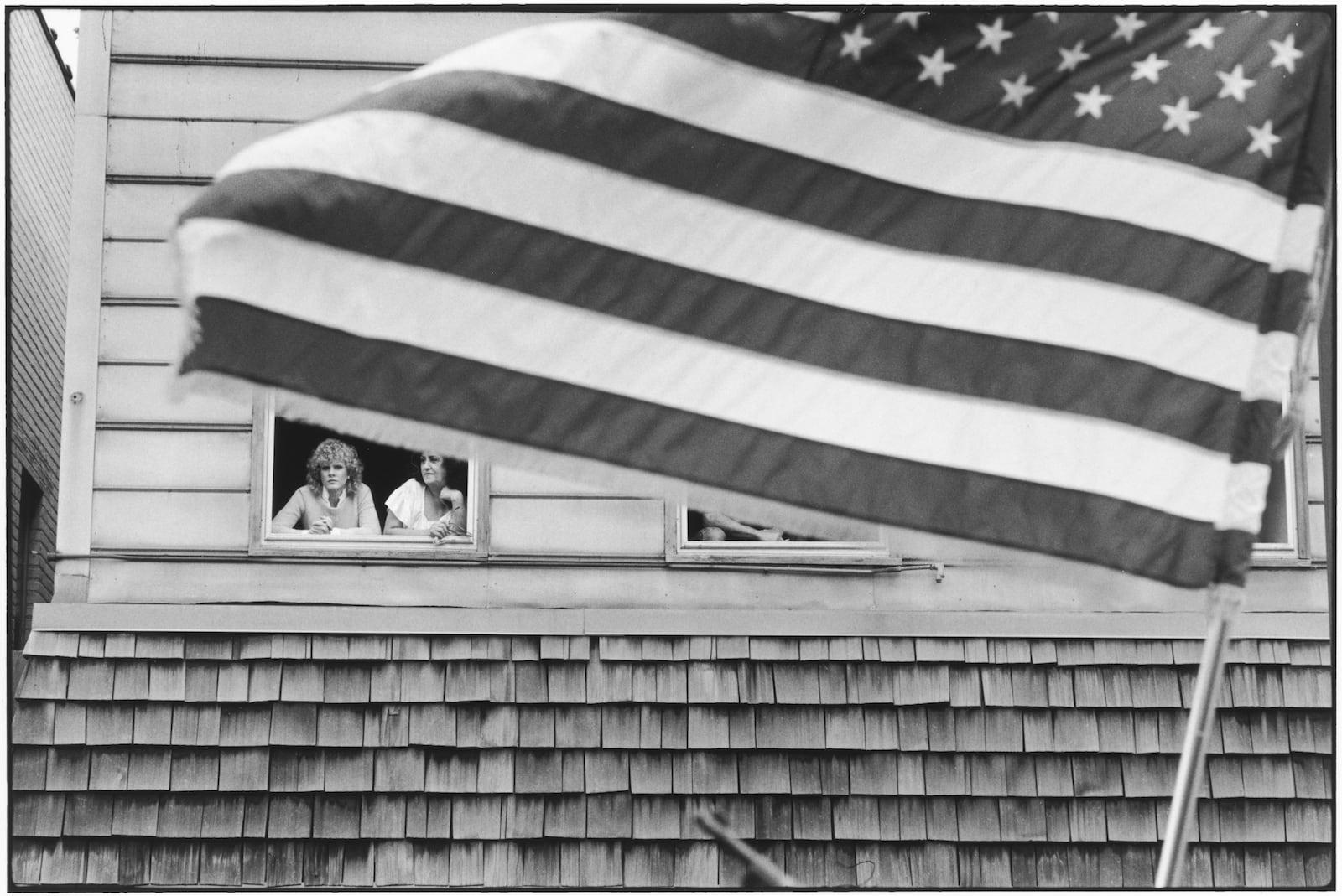 Tom Arndt, Two women & the flag, Payne Avenue, Saint Paul, Minnesota, 1982