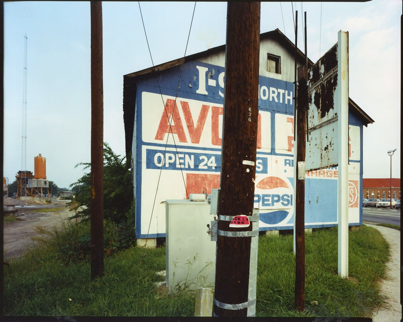 Bruce Wrighton, Utility poles in front of red/blue/withe sign (with Pepsi)