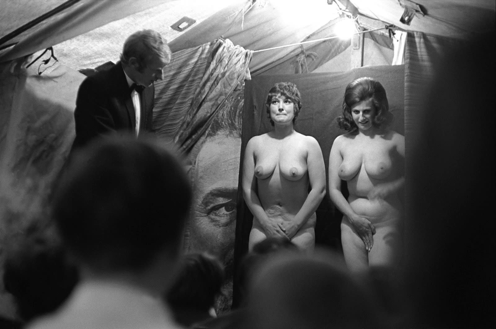 Homer Sykes, Strip tease tent, with Humphrey Bogart, Pinner Fair, Middlesex, 1971