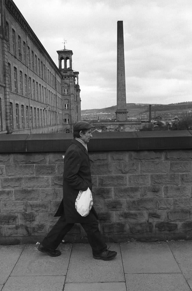 Homer Sykes, Factory worker going home, Salts Cotton Mill, Saltaire, Yorkshire, 1981
