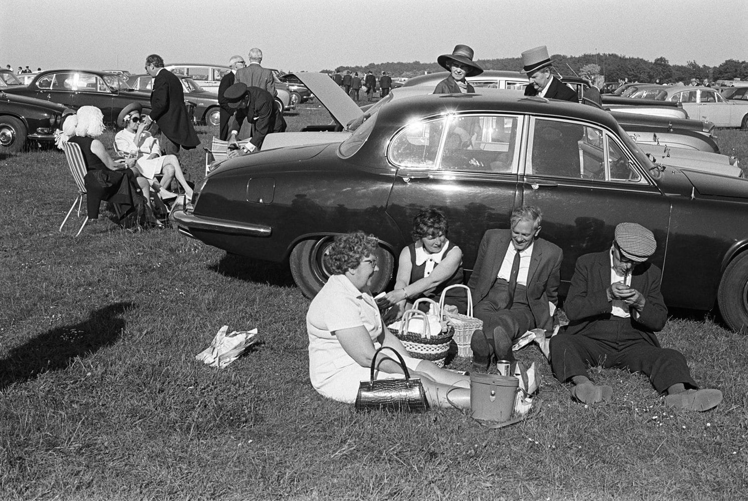 Homer Sykes, A day at the races, Derby Day picnic horse racing at Epsom Downs, Surrey, 1970