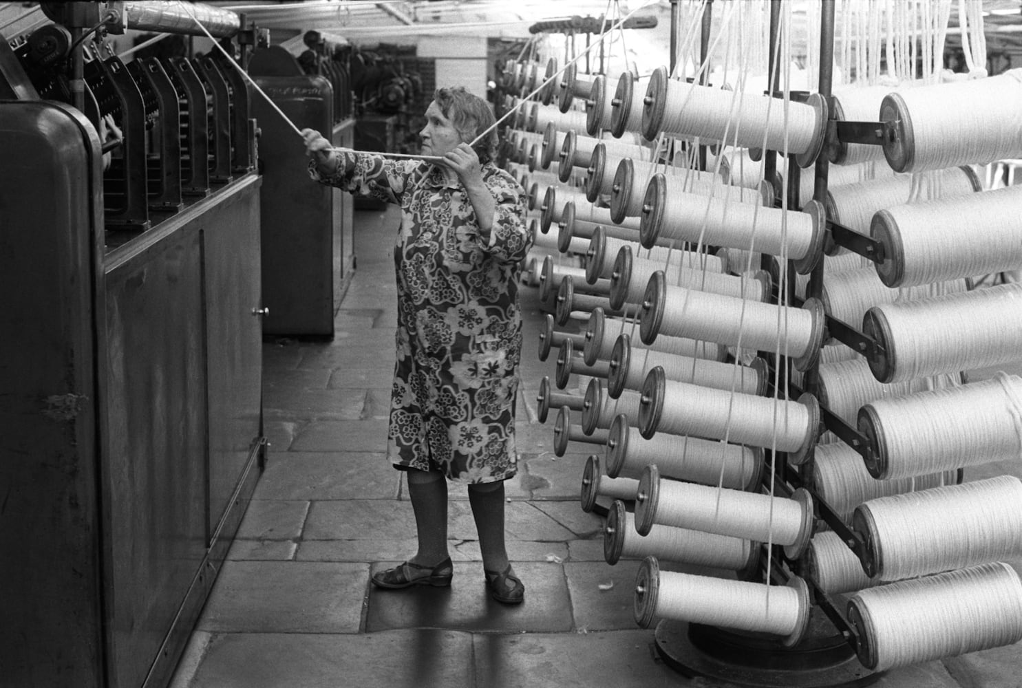 Homer Sykes, Factory work, woman working in Salts Mill Saltaire Yorkshire, 1981