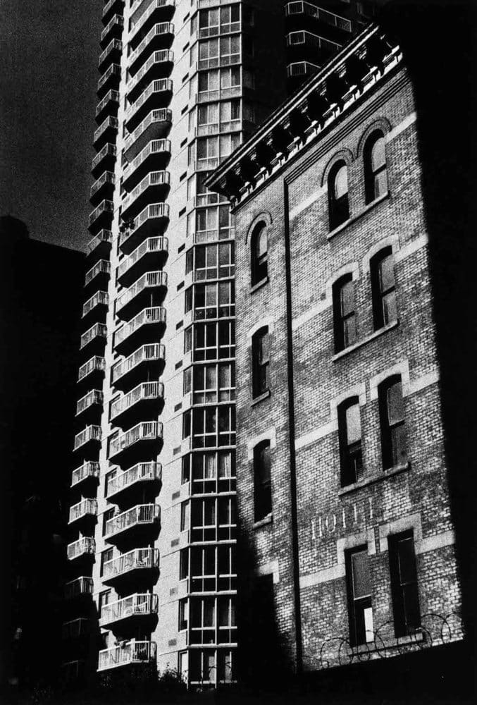 Sid Kaplan, New building to left of old building, East 24th. St. New York City, c. 1990