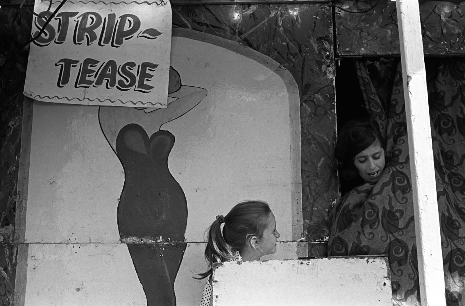 Homer Sykes, Striptease booth, mother and daughter. Derby Day, Epsom Downs, Surrey, 1969