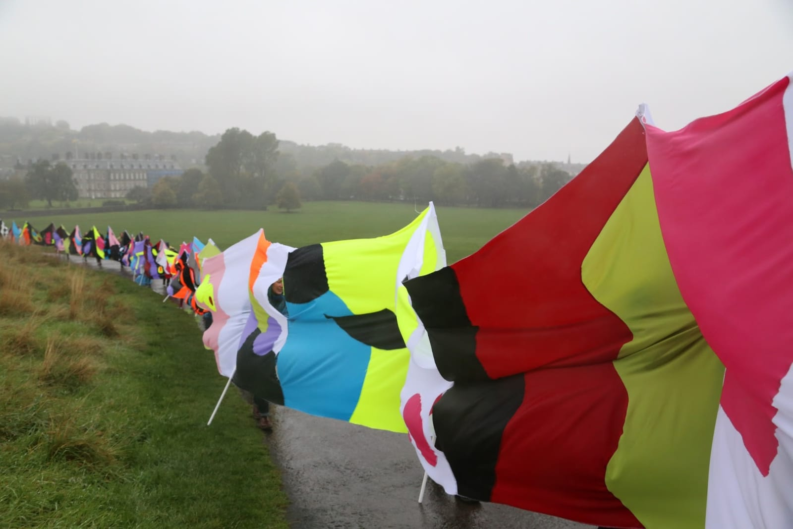 Jacob Dahlgren No Conflict no Irony (I Love the Whole World), 2013. The making of a 100 meter long banner and the walk to Salisbury Crags on 17 October 2013, Sweden