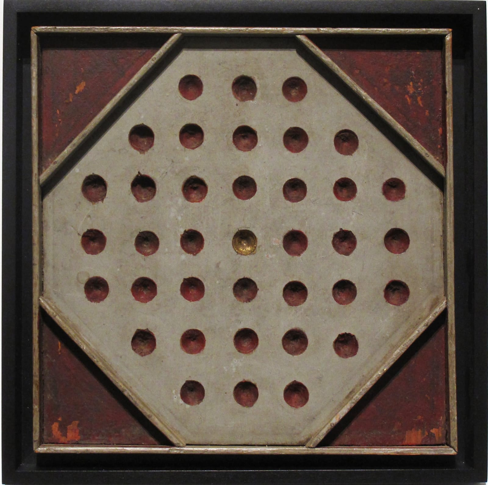 SOLITAIRE GAME BOARD, C. 1900-1910 Joined and carved wood with polychrome 11 1/2 x 11 1/2 in. 29.2 x 29.2 cm. (AU 294)