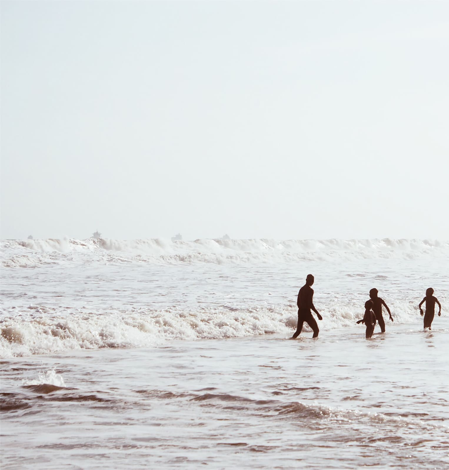 Arinzechukwu Patrick A man plays and his kids play with the waves 28 x 28 cm 21 x 21 cm Digital print