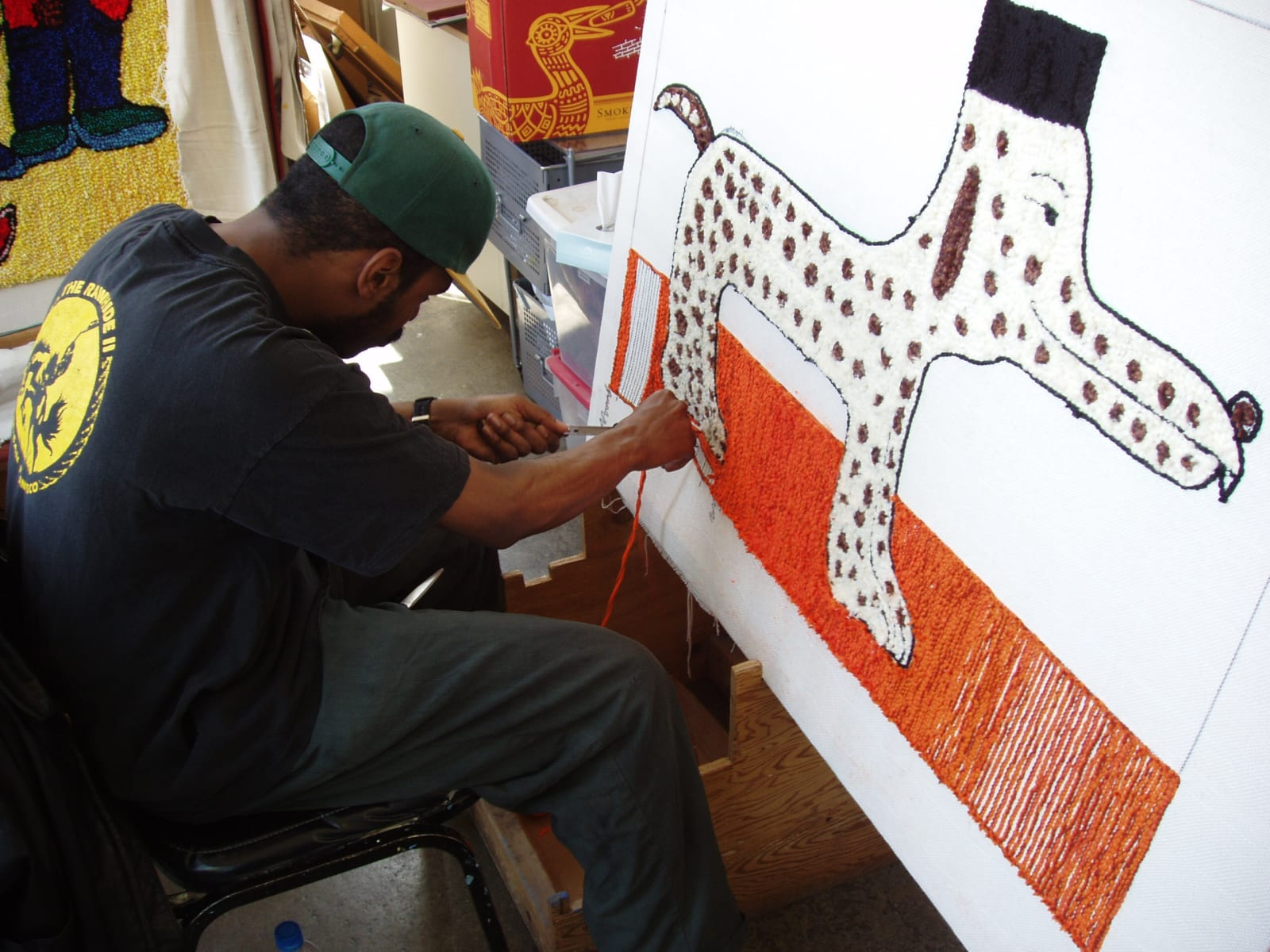 Creative Growth alum Gerone Spruill hooking a rug of his own design.