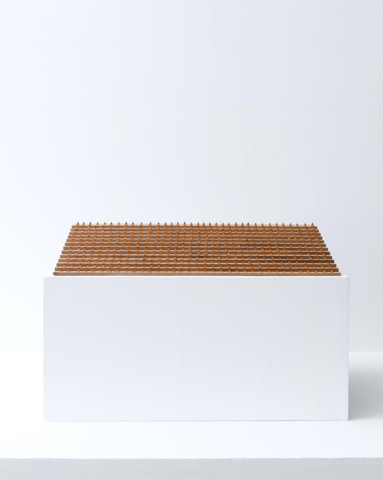 Sitting Monks, 2018, Yakal wood, plastic, and acrylic, 13 x 91.5 x 51 cm