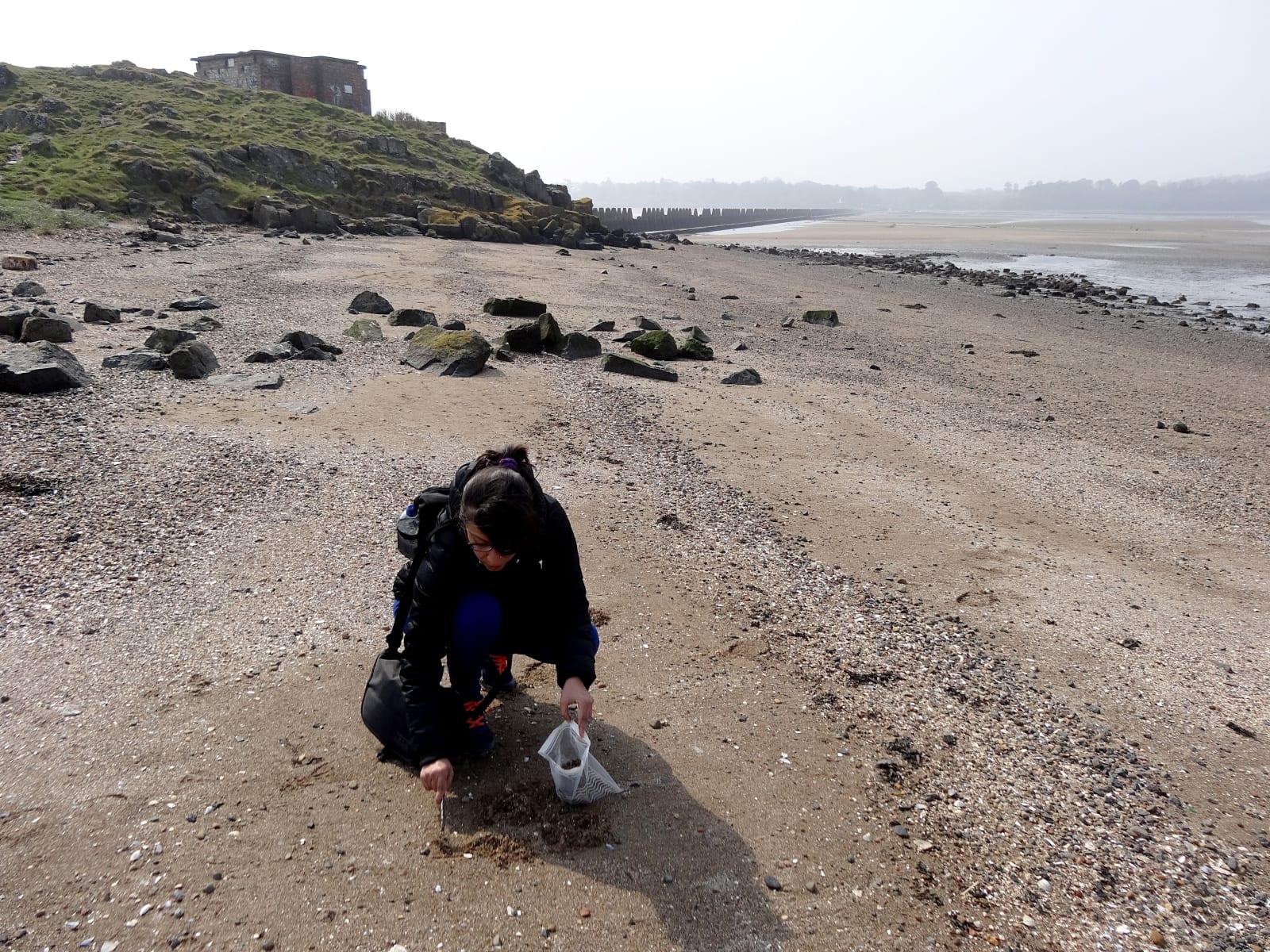 Sonia collecting environmental samples at Cramond Island